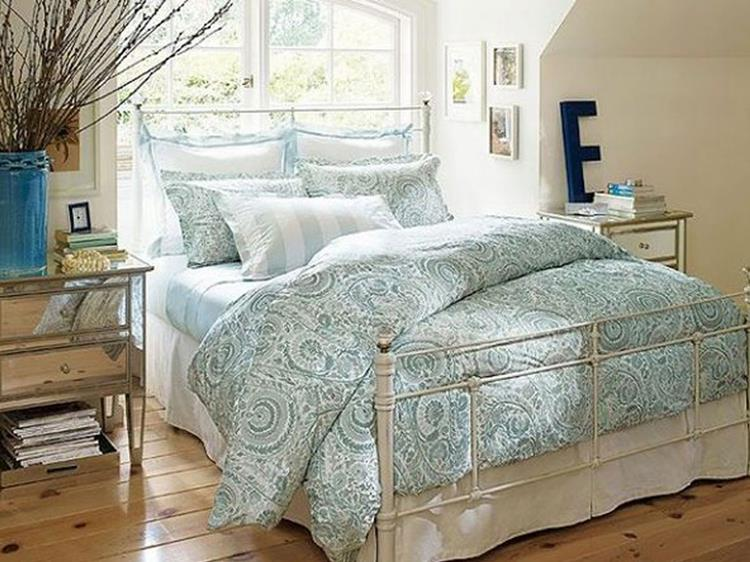 charming retro pattern bedding set with white wrought iron bed design in vintage bedroom idea plus hardwood flooring and mirrored cabinets
