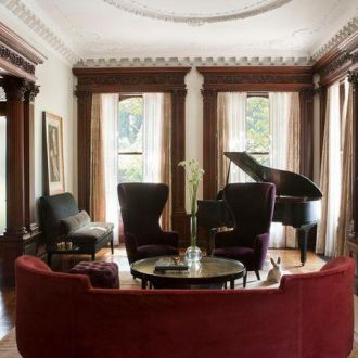 curved-red-deep-sofa-piano-room